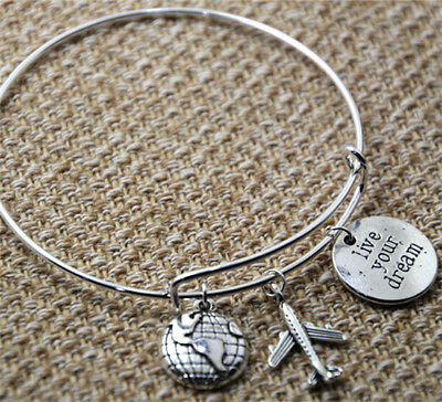 - Travel Bracelet with world airplane and stamped live your dream for the traveler