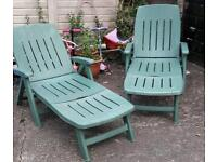 Two plastic sun loungers