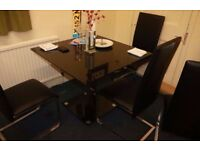 Quality glass dining table and 4 leather chairs