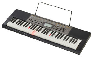 Casio LK-265 Musical Keyboard, Bench and Stand Included