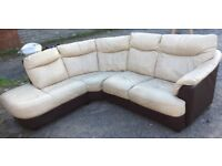 Leather corner sofa suite including electric recliner