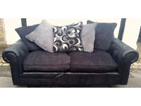 Black 2 seater sofa with scatter cushions