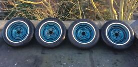 14'' Chevy wheels with thin whitewalls, chevrolet / jaguar pattern