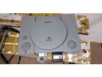 PS1 with 4 games and 2 controllers