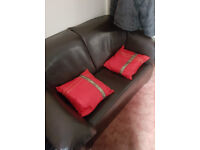 FREE two seater couch Brown leatherette good condition