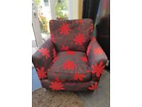red and black flower arm chair