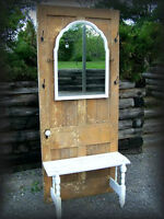 Beautiful rustic old door with seat, mirror and hooks