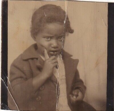VINTAGE PHOTO BOOTH -ADORABLE, SKEPTICAL AFRICAN-AMERICAN CHILD-FINGER ON CHEEK](Kids Photo Booth)