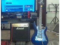 IBANEZ GIO GUITAR AND MARSHALL MG15CDR AMP.