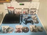 Ps3 console slim 160gig + jeux Assassins Creed - 150$