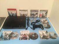 Ps3 console slim 250gig + jeux Assassins Creed - 150$