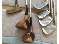 1/2 set of golf clubs including traditional woods and bag