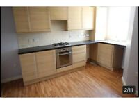 Beech wood kitchen units + black granite look worktop + sink
