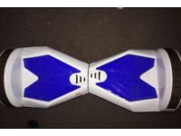 Blue and white Segway board