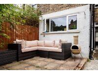 Brown Rattan Garden Corner Sofa including centre table