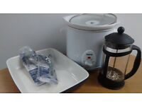 blue ceramic baking dish, cafetiere, slow cooker and buffet forks