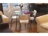 Glass table (and chairs) for sale
