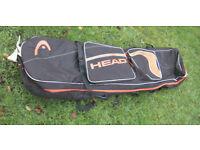 HEAD double ski/board bag. Black & orange fits 2 pr skis & poles pockets for goggles/gloves etc.