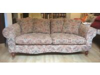 3 seater sofa, hardwood frame, brass wheels, removable cushion covers, excellent condition.