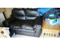 Brown two seater couch.