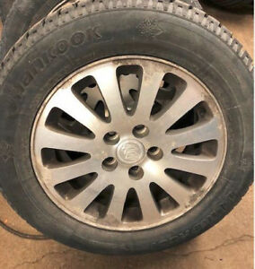 Set of 4 Buick alloy rims with 225 60 R16 snow tires