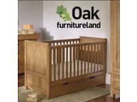 Solid oak cot / toddler bed (oak furniture land)