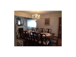 Wood Dining room set with ten chairs