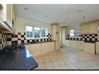 Kitchen with quartz/granite work surfaces