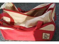 Red changing bag