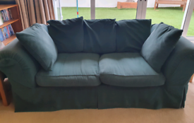 Three-seater sofa with removable covers and loose cushioned back