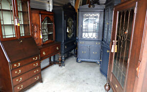 ** A collection of refinished antique display cabinets (delivery