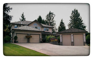STUNNING MILLION + $ HOME + COACH HOME + SHOP ON 24800 SQ FT LOT