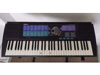 Yamaha Portatone PSR-185 electric keyboard with stand and owners manual