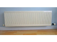 Off-white central heating radiator complete with Danfoss thermostatic radiator valve and brackets.