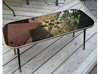 VINTAGE GLASS TOP COFFEE TABLE.