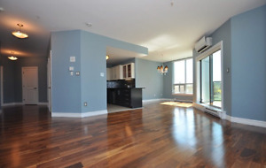3 bedroom modern open concept main floor condo