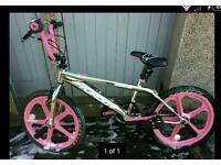 Rooster big daddy 20 inch chrome/pink unisex used bmx with skyway mag wheels.