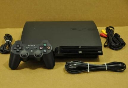Black Sony PS 3 console with controller and wires for tv