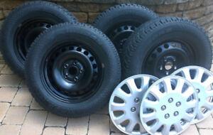 4 winter tires on steel rims-4 pneus d'hiver sur jantes en acier