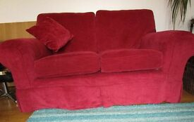 Pair of Marks and Spencer sofas, red velour loose covers