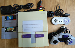 Super nintendo SNES 2 controllers, hookups and 2 mario games