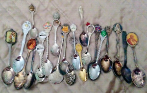 Lot of silver spoons and Thimbals etc...