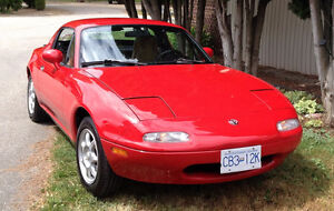 Head turning Red 1994 Mazda MX-5 Miata Convertible