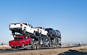 Hauling heavy equipment and farm equipment in Canada and Usa