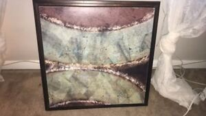 Brown  wooden framed painting