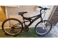 Raleigh Mission Mountain Bike. 18 speed. 26 inch wheels (Suit: 16 yrs to Adult).