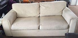 Comfy beige 2-seater sofa
