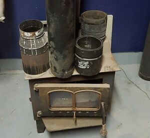 WOOD BURNING STOVE WITH BLOWER, PIPE AND CONNECTORS