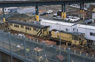 NYCTA slide. General Electric work diesel 887 and x-R33 subway car RD433