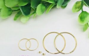 """''Oops hoops"""" 18K yellow gold earrings with 24K gold charms"""